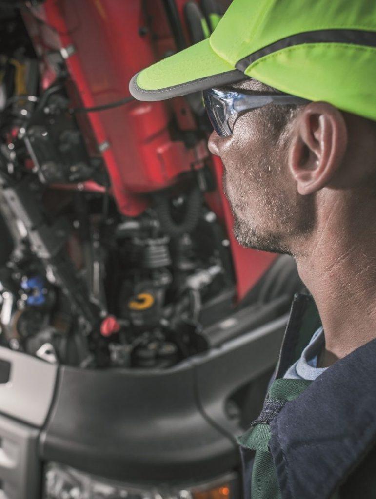 Engineer next to open truck